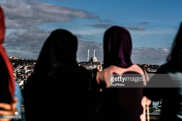 Women looking at the city from Pierre Loti hill in Eyup Istanbul on