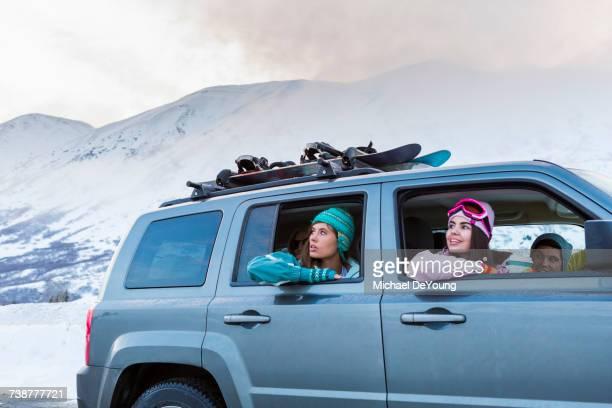 Women looking from car windows in winter