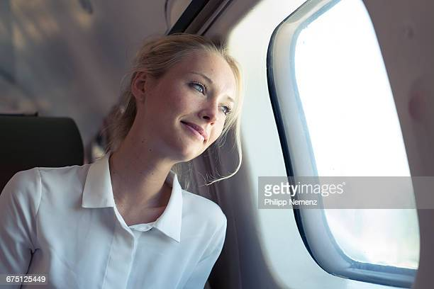 women looking out of plane window