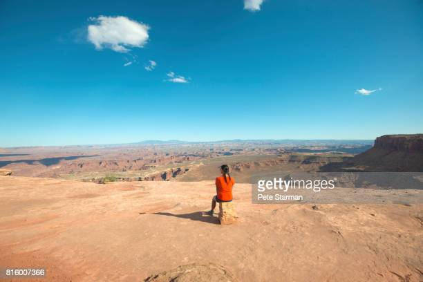 women looking out over white rim overlook, utah. - filipino ethnicity and female not male fotografías e imágenes de stock