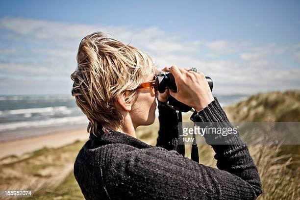 women looking through binoculars - binoculars stock pictures, royalty-free photos & images