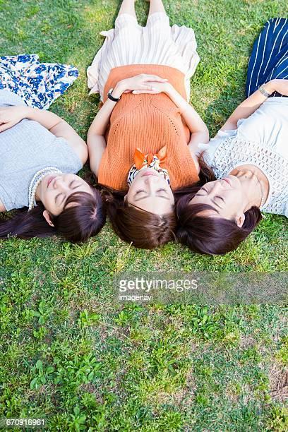 Women lying on the lawn