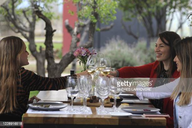 Women make a toast at Argentinian agronomist and winemaker Alejandro Vigil's Casa Vigil winery, restaurant and art space, in Chachingo, Maipu...
