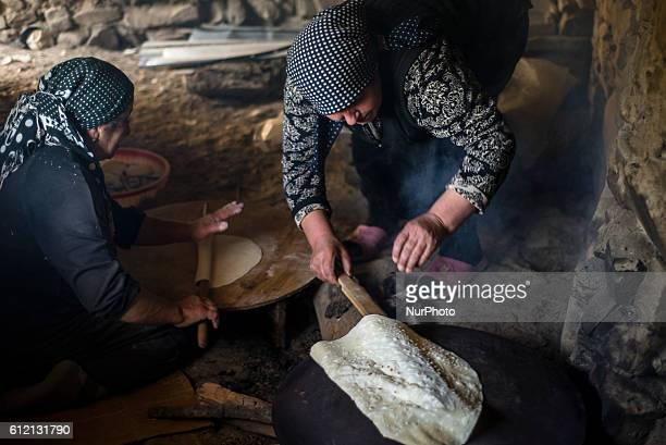 Women make bread in the kitchen of her house in Khinalig village Quba region Azerbaijan Traditional bread for this village is lavash very thin...