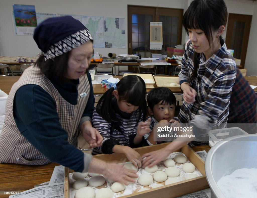 Women make rice cakes, Mochi for celebrations of the forthcoming Year of the Dragon, at Zuiganji temple on December 28, 2012 in Himeji, Japan. The Japanese calendar is divided into twelve parts and are commonly associated with the twelve animals, the Mouse, Cow, Tiger, Rabbit, Dragon, Snake, Horse, Sheep, Monkey, Rooster, Dog and the Pig.