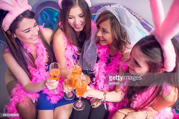 Women making a toast at a bachelorette party