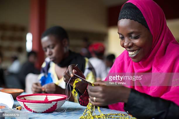 women making clothes, kigali, rwanda - rwanda stock pictures, royalty-free photos & images