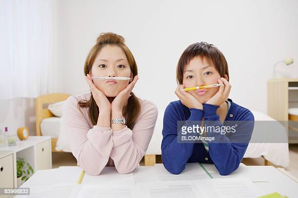 Women making funny expression