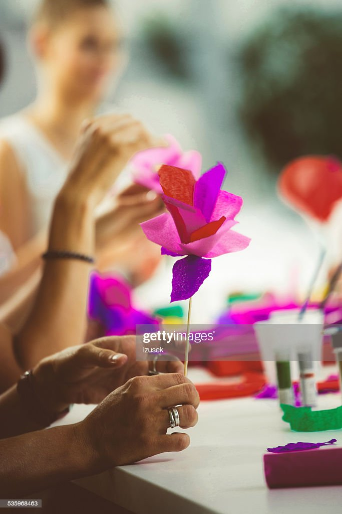 Women making paper flowers : Stock Photo