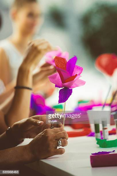 women making paper flowers - izusek stock pictures, royalty-free photos & images