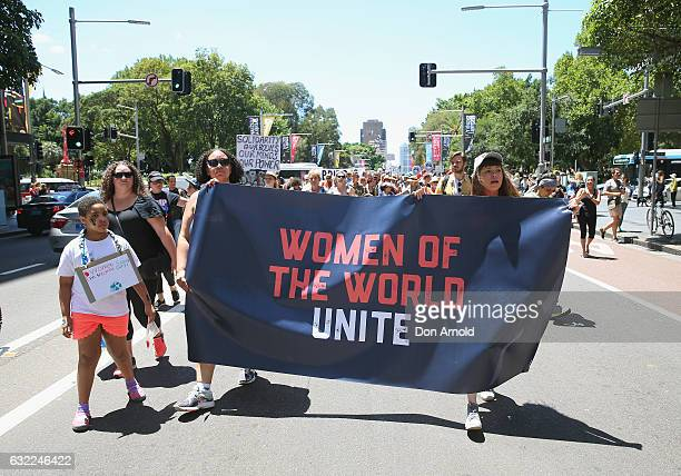 Women march down Park St on January 21 2017 in Sydney Australia The marches in Australia were organised to show solidarity with those marching on...