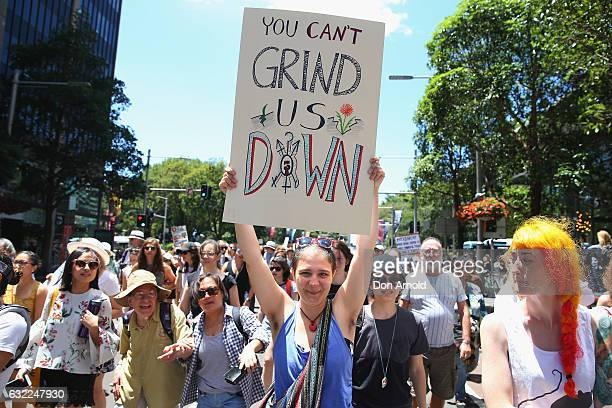 Women march down Park St on January 21, 2017 in Sydney, Australia. The marches in Australia were organised to show solidarity with those marching on...