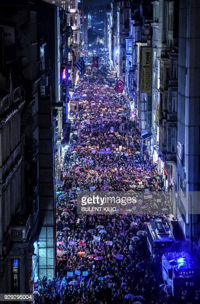 Women march on Istiklal avenue in Istanbul on March 8 February 2018 during a demonstration to mark International Women's Day / AFP PHOTO / BULENT...