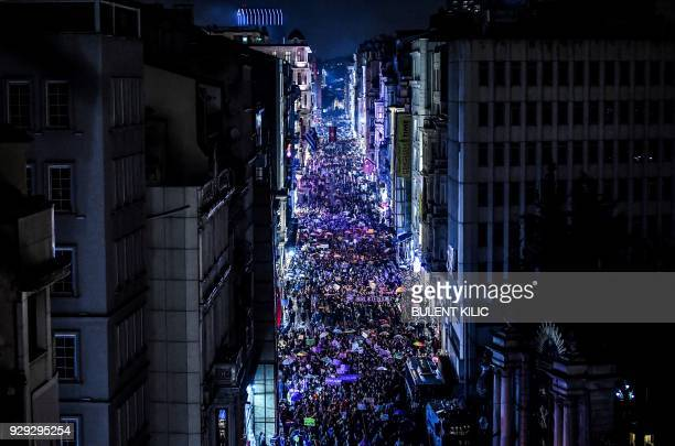 TOPSHOT Women march on Istiklal avenue in Istanbul on March 8 February 2018 during a demonstration to mark International Women's Day / AFP PHOTO /...