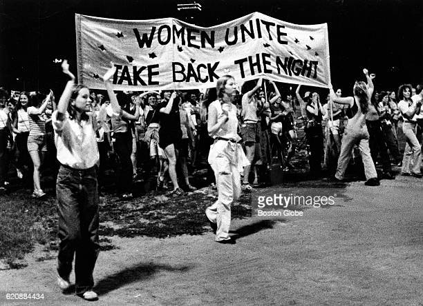 Women march to Roberto Clementi Field in Boston to protest a continuing trend of violence against women and minorities in the city on Aug. 9, 1980.