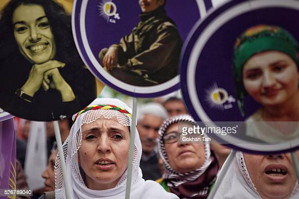 Women march with banners in Istanbul's Bakirkoy district to celebrate May Day on May 1, 2016 in Istanbul, Turkey. Turkish police used tear gas and...