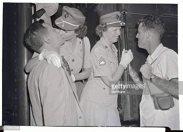 Women Marines Corporal Virginia Kegel and Technical Sergeant Josephine Gibson bid farewell to their husbands as they leave Union Station for camp...