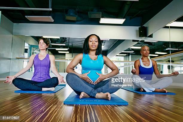 Women meditating in yoga studio