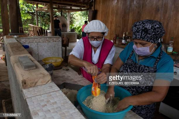 Women, members of a company of typical food, cook for tourists in Guanacaste, Costa Rica, on August 24, 2021. - Costa Rica has recovered in the...