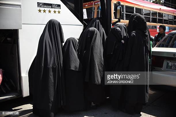 Women members of an Orthodox Jewish group are seen in the vicinity of the building where they were living in Guatemala city on September 252016 A...