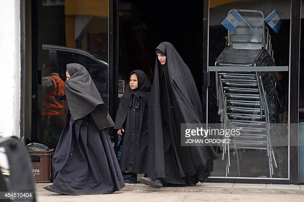 Women members of an ultraOrthodox Jewish group are seen at the entrance of the building where they will remain in Guatemala City on September 2 2014...