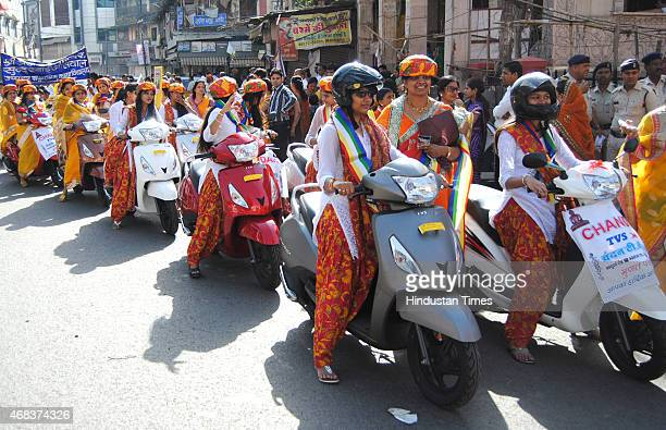 Women members of Jain community took out twowheeler rally to propagate message of peace and non violence on the occasion of Mahavir Jayanti on April...