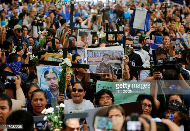 Women members of the Mothers of April association attend mass in honor of their children killed during the protests against the government of...