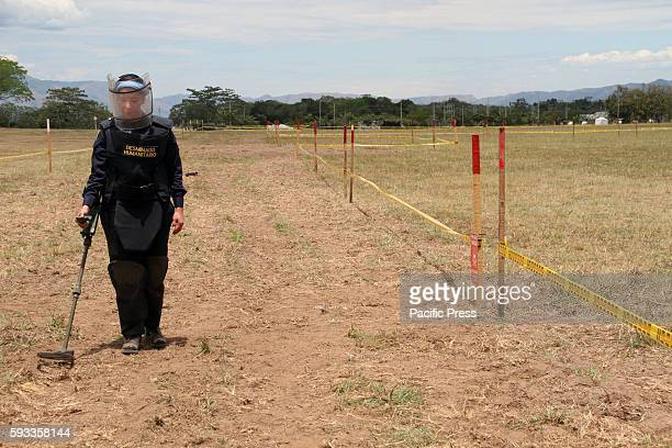 Women members of the National Army of Colombia during a demonstration exercises showing the detecting of landmines at the military base in Tolemaida,...