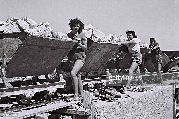 Women members of this pioneering Zionist community work in the quarry August 1 1941 of Kibbutz Ein Harod during the British Mandate of Palestine in...