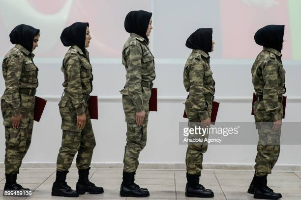 Women military officers from Afghan National Army are seen as they receive their certificates after completing the nine-weeks training program...