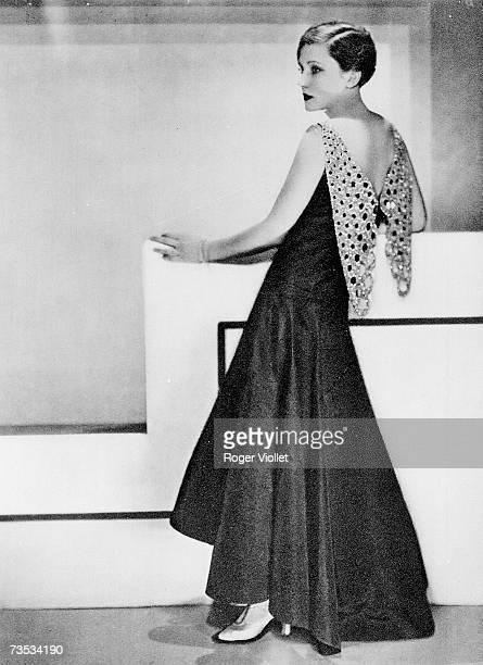 Women models a dress of Jeanne Lanvin's black fault. On 1929 in Paris, France.