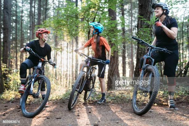 women mountain biking team - mountain bike stock pictures, royalty-free photos & images