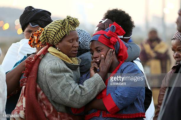 Women mourn as family members of the 34 people who died when police opened fire on strikers at the Lonmin platinum mine north west of Johannesburg on...
