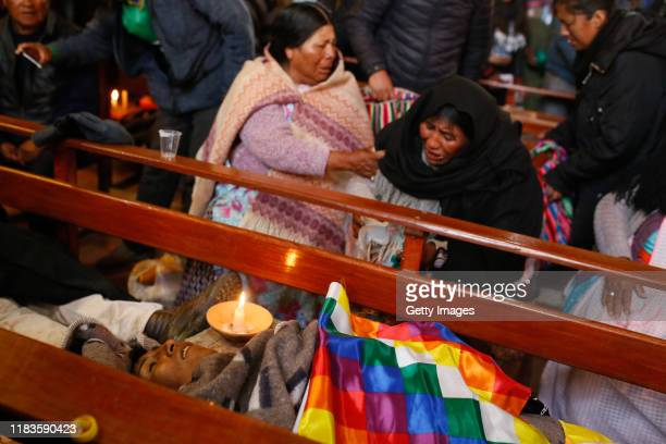 Women mourn during the funeral of people killed yesterday during clashes between supporters of Evo Morales and security forces in the entrance of a...