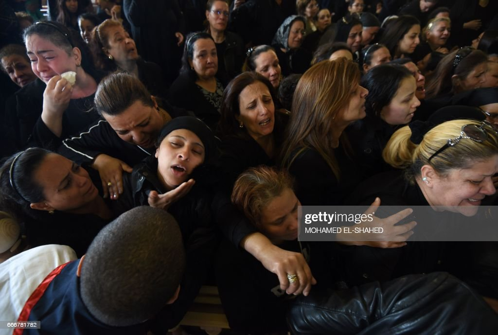 TOPSHOT - Women mourn for the victims of the blast at the Coptic Christian Saint Mark's church in Alexandria the previous day during a funeral procession at the Monastery of Marmina in the city of Borg El-Arab, east of Alexandria on April 10, 2017. Egypt prepared to impose a state of emergency after jihadist bombings killed dozens at two churches in the deadliest attacks in recent memory on the country's Coptic Christian minority. /