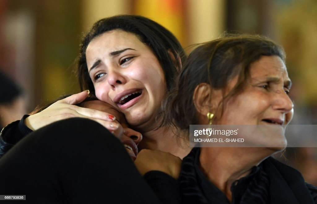 TOPSHOT - Women mourn for the victims of the blast at the Coptic Christian Saint Mark's church in Alexandria the previous day during a funeral procession at the Monastery of Marmina in the city of Borg El-Arab, east of Alexandria, on April 10, 2017. Egypt prepared to impose a state of emergency after jihadist bombings killed dozens at two churches in the deadliest attacks in recent memory on the country's Coptic Christian minority. /