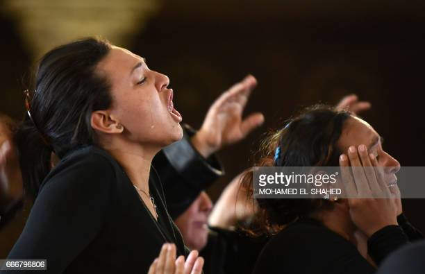 Women mourn for the victims of the blast at the Coptic Christian Saint Mark's church in Alexandria the previous day during a funeral procession at...