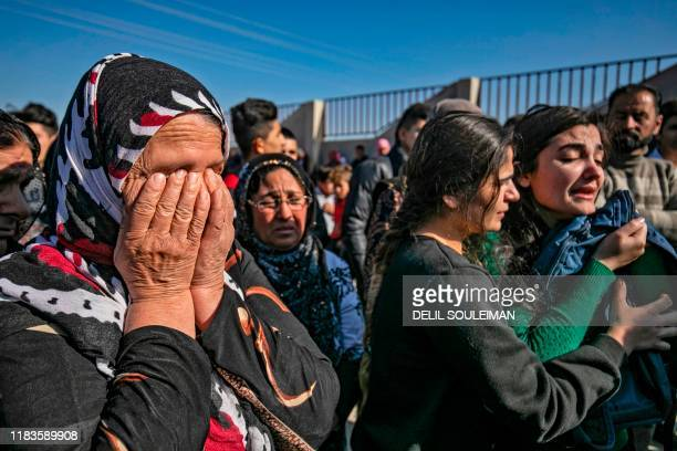 Women mourn in the Syrian Kurdishmajority city of Qamishli on November 20 during the funeral of Noubar Ibrahim a school pupil who died of wounds...