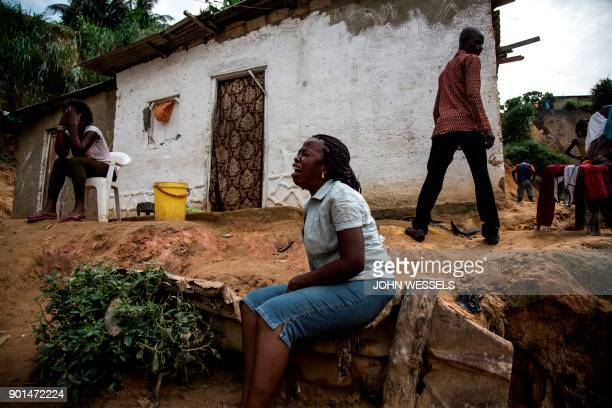 TOPSHOT Women mourn the death of a family member following a landslide on January 5 2018 in Kinshasa Thirtyseven people died overnight when...
