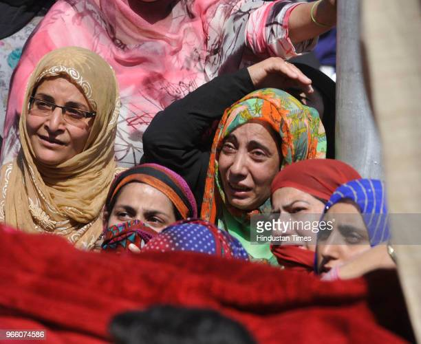 Women mourn the death of Kaiser Amin Bhat during his funeral procession at Fateh Kadal on June 2 2018 in Srinagar India Clashes erupted between...