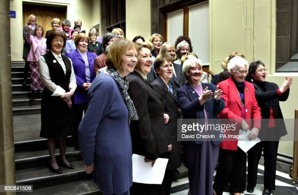 Women MSPs gather at the Scottish Parliament in Edinburgh for a photocall to mark International Women`s Day Left to right front row Margaret Ewing...