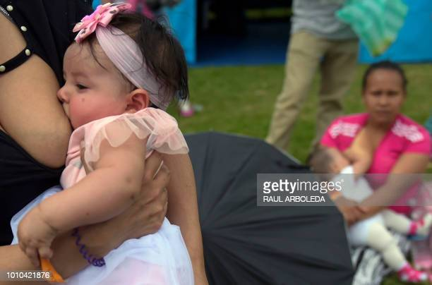 Women nurse their children during a public event to promote the benefits of breastfeeding during the World Breastfeeding Week at a park in Bogota on...