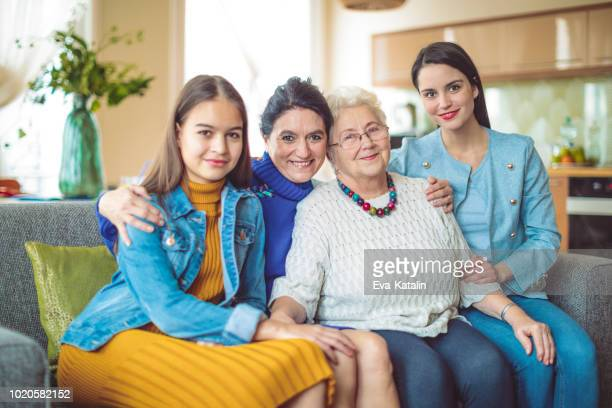 women of a multigeneration family are posing together - four people stock pictures, royalty-free photos & images