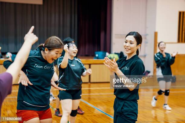 women of all ages laughing and having fun during a community league volleyball practice - sports training drill stock pictures, royalty-free photos & images