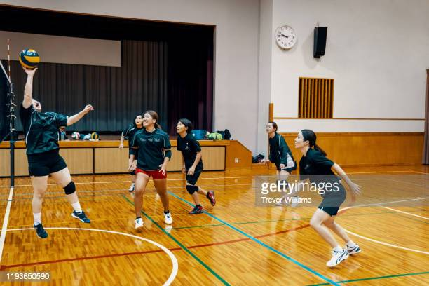 women of all ages playing volleyball together in a community league - sports training drill stock pictures, royalty-free photos & images