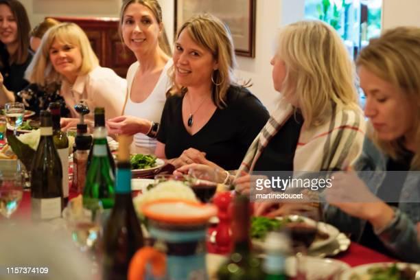 Women of all generations having dinner.