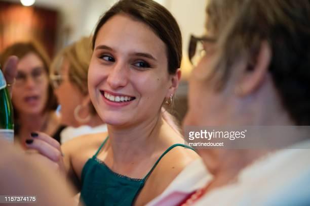 """women of all generations having dinner. - """"martine doucet"""" or martinedoucet bildbanksfoton och bilder"""