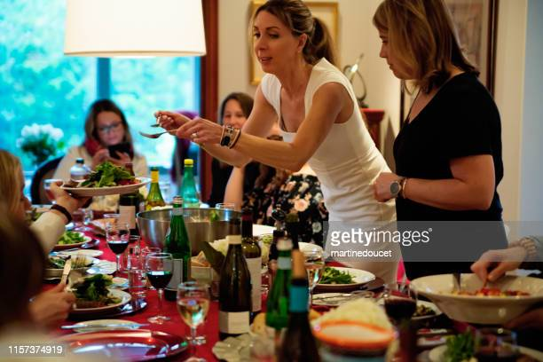 """women of all generations having dinner. - """"martine doucet"""" or martinedoucet stock pictures, royalty-free photos & images"""
