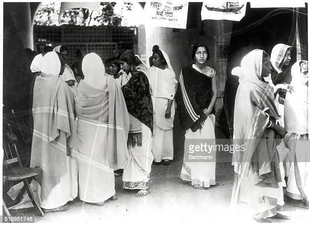 Women of India await their turn to vote