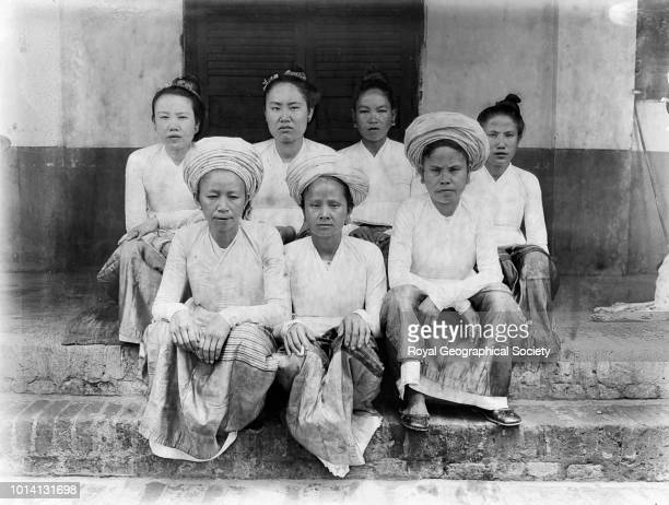 'Laotien women of Laos They look rather savage Their dress consists of a striped brightly coloured skirt and white jacket They often wear jewellery...